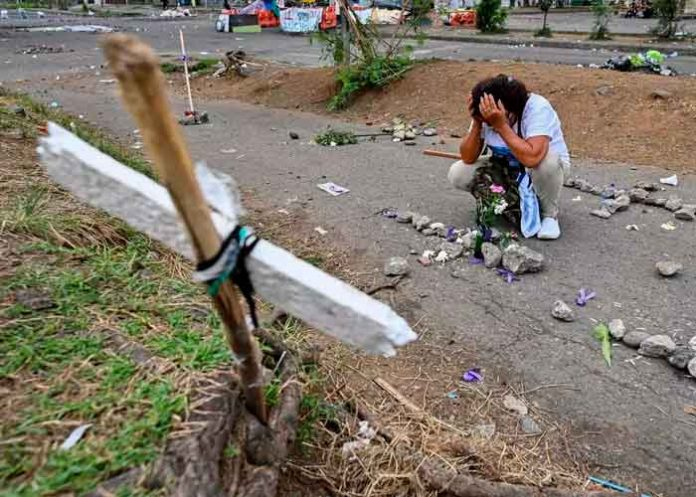 colombia, reporte, asesinato, manifestantes, cali,