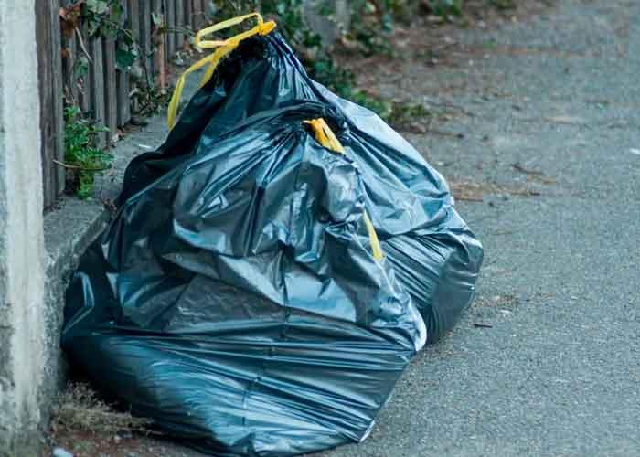 en bolsa negras de basura metieron los cuerpos descuartizados de la familia
