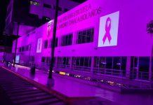 Fachada del Hospital Militar con imagen alusiva a la prevención del cáncer de mama